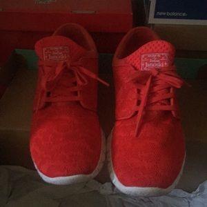 Red/orange Nike shoes for men